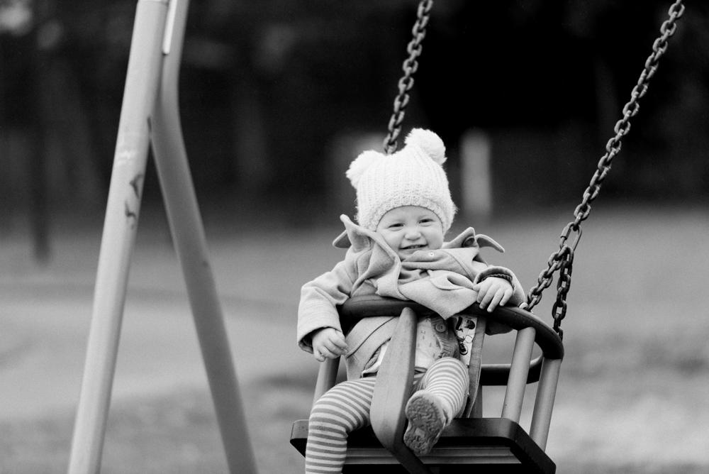 Toddler having fun on swing